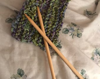 Knitting Needles (US 11/8.0 mm) and the failed knitting project they knit.
