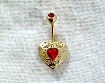 Gold w/ red/pink gem belly ring