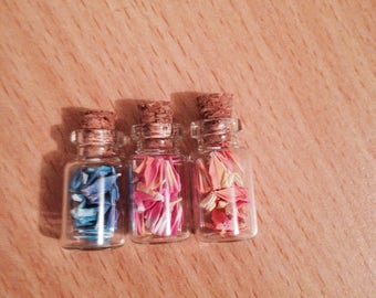 3 tiny bottles of origami cranes