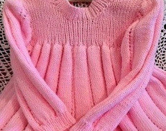 Beautiful hand knitted baby dress