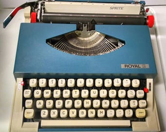 1970s Vintage Portable Royal Sprite typewriter in dark teal blue