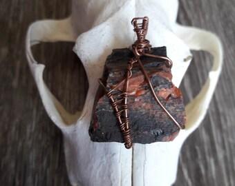 Copper warrior, petrified wood