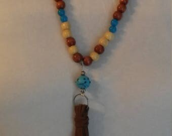 wooden brown and light brown with blue tassel necklace