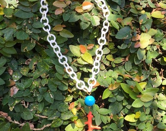 White Plastic Necklace with Coral Charm