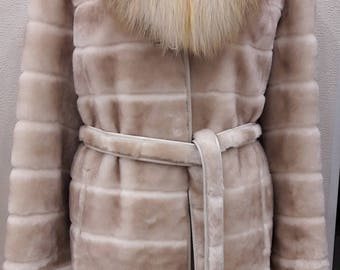 New elegant mouton fur coat with a fox collar . Year 2017
