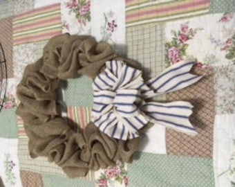 small burlap with navy stripes ribbon