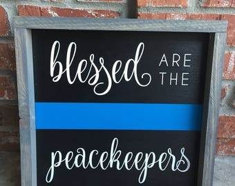 Blessed are the peacekeepers (wood sign)