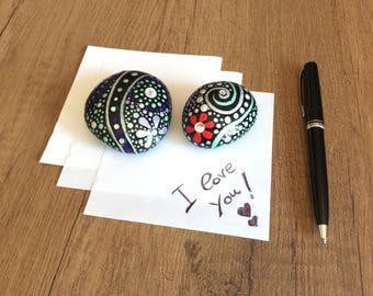 Pair of hand-painted stones with glitter and Rhinestones, to use as a paperweight or desk for home furnishing