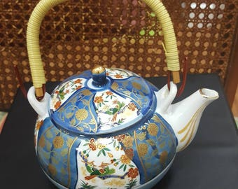 Japenese Vintage Teaport  which has Floral and Bird Pattern