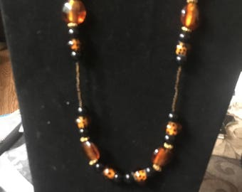 Black , gold and orange beaded glass necklace and earrings