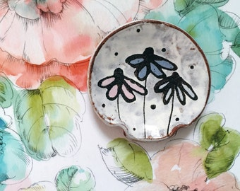 Pottery spoon rest with flower drawing and polka dots - ceramic dish spoonrest little bowl - cone flowers pink blue black white