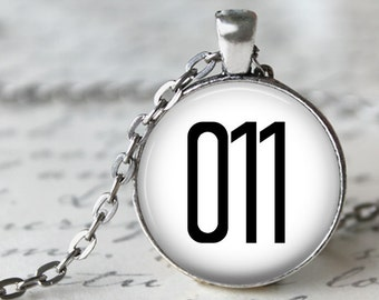 Stranger Things 011 on White Background Pendant Necklace or Key Chain in choice of Silver, Bronze, Copper or Black Bezel