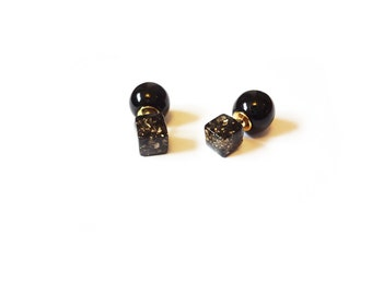 double-sided, two-way black resin cube with gold flakes