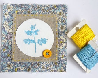 Mini textile art / original applique. Hand embroidery, floral print fabric, button. Spring teal blue & yellow
