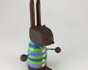 Bunny in a Green Striped Sweater