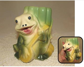 Vintage Ceramic Green Frog Playing a Yellow Banjo Vase, leaning on a stalk of Cattails