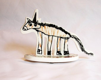 small porcelain unicorn with underglaze drawing, overglaze decals and bright gold luster