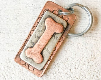 Our dog tags make a unique personalized gift. Each pet id tag is crafted in our Bozeman, Montana studio by dog lovers. Whimsy Bone Pet Tag