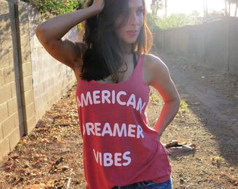American Dreamer Vibes.  Slouchy Racer Tank.  Sizes S-XL.  Made in the USA.  8 Colors to Choose From.  4th of July Tank.  Summer Tank Top