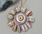 Ivory studies - Everything else and a wheel - Lampwork beads by Loupiac