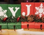 Green one left only :)  JOY Stocking Holders your choice Red or Green