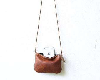 49% off - small leather case with cross body strap - small leather cross body bag