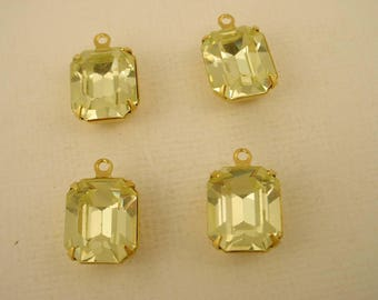4 vintage glass Swarovski Jonquil yellow  Octagon 12x10 stones  closed  back brass setting 1 ring charms