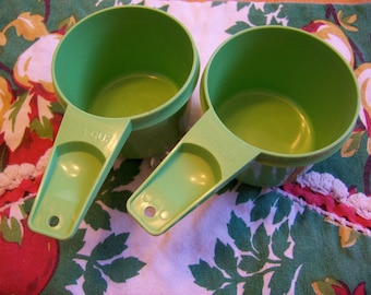 two fun tupperware measuring cups