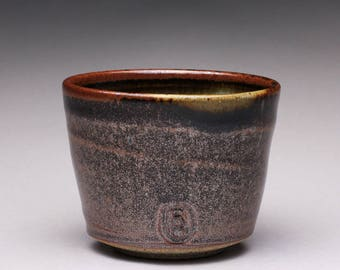 handmade ceramic tea cup, pottery cup, yunomi with black brown tenmoku and green celadon glazes