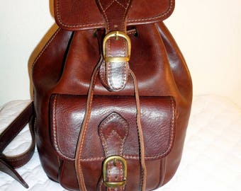 Italian  vacchetta leather mahogany bown heavy durable backpack , sling bag , tote , satchel awesome