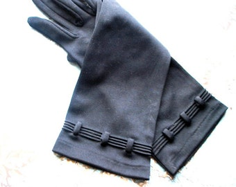 Art deco vintage 60s black nylon gloves with a pin tack details. Size 7- 7 1/2