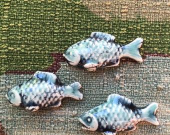 10 Porcelain fish tiles, cabochon