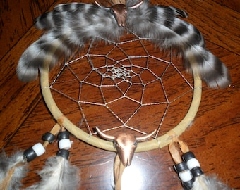 Handmade tan Dream Catcher with black and white Guinea Hen feathers