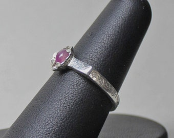 ancient to sixteenth century style ring set with pink sappire cab size 7 1/2