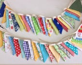 12.5ft bunting comprising of 26 small flags in a mix of bright fabrics, great for any party, bottom row available
