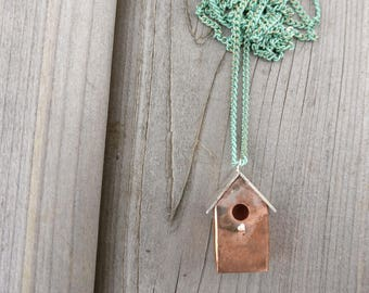 Mixed metal birdhouse necklace