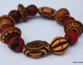 """Beaded Bracelet textured combination of reds and earth colors 6"""""""