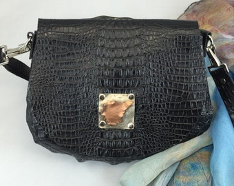 Handmade Embossed Black Leather Bag with Forged Metal Leaf Accent