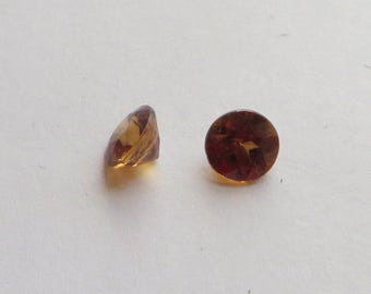 Pair of Natural Dark Honey Zircon Gemstones, 6mm round cut faceted stones, 2 carats total, for a pair of earrings?