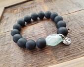 Mens bold black onyx bracelet with .925 Sterling Silver OM and large light green flourite gemstone