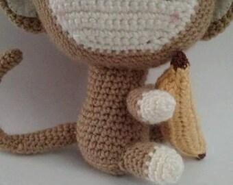 Stuffed monkey toy with banana crocheted