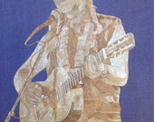 Willie Nelson portrait handmade with rice straw (Dried leaves of rice plant) country music legend Willie Nelson On the road again on leaves