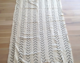 African white woven mudcloth textile fabric with black markings