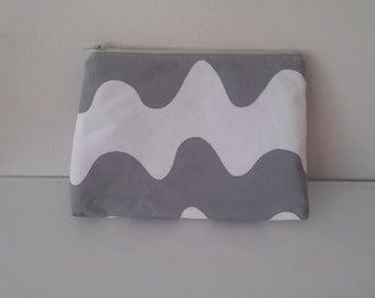 Toilet bag made of  light gray and white LOKKI fabric of Marimekko cotton Maija Isola