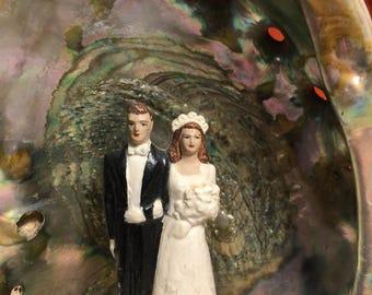 1940s plaster wedding cake topper in an abalone shell