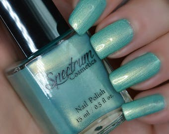 SEA SERPENT Shimmery green nail polish with gold iridescence