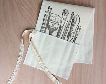 Hand printed brush roll holder with lace ties