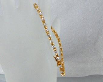 CHRISTMAS SALE Vintage Tennis Bracelet.  Gold Over Sterling Silver.  Cubic Zirconia.