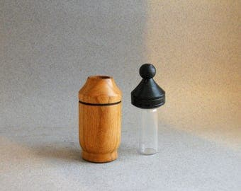 Small turned wood vial to hold perfume or essential oil