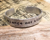SCIENCE NOT SILENCE; hand hammered and stamped aluminum cuff bracelet